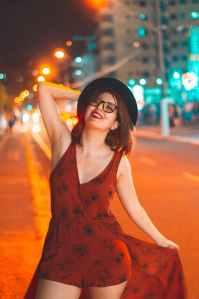 woman in orange dress posing in the street